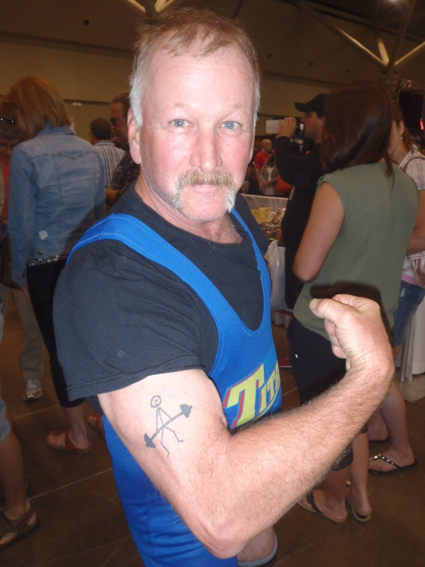 My dad, showing off the deadlift tattoo that I drew for him over ten years ago
